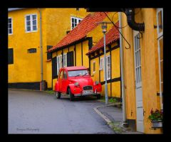 yellow houses, red car by burcyna