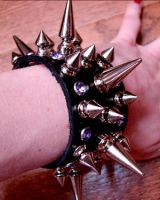 Spiked leather bracelet by tHeOnLyCaLaMiTy