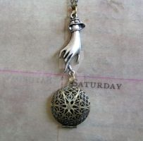 Locket with victorian hand by GraceCM