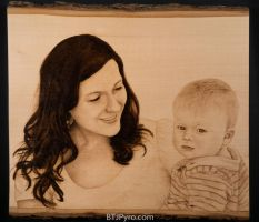 Mother and child - handcrafted woodburning by brandojones