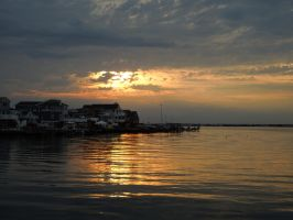 stormy inlet sunset by Singinchic7