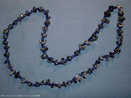 Obsidian Snowflake and blue glass bead necklace by KhaoticallyKreative