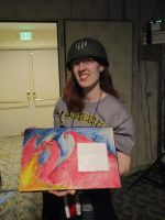 Laura Red Gierach Scott holding her D and D book by Poorartman