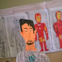 Tony Stark in his garage next to the hall of armor by movieman410