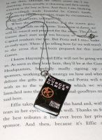 The Hunger Games Pendant by melijan