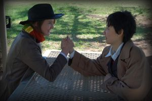 4 and 10 Doctor arm wrestle by AuberyMirkwood
