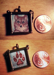 Wolf and Paw- framed pendant by TaksArt
