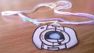 Portal: Wheatley Paper Child Necklace by DreamForecast