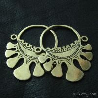 Bronze temple rings from medieval Rus by Sulislaw