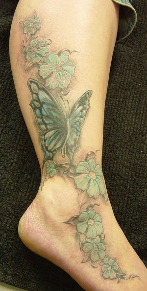 design butterfly color tattoo and like this image place for foot tattoo but