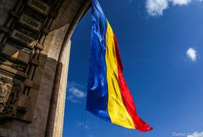 Romanian Flag and The Triumphal Arch Bucharest by DanielComan