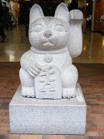 lucky cat statue by SammiStock