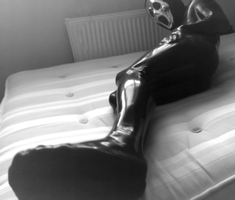 Trapped in latex. by encased1