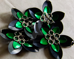 Black and Green Scale Flowers by NebulaDraconian