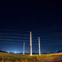 Power Following the Horizon Under the Night Sky by jwdonley