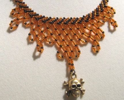 Skull and crossbones Necklace by BeadfulStrings