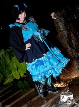 blue voodoo doll in the tropical heat of the night by trixyloupwolf