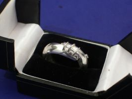 Silver stitched ring by BaronBernard