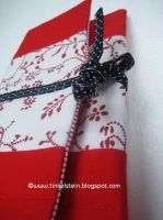 sewn red and white wallet by tinkelstein