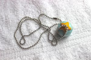 Good Luck Shiny Star Macaroon Pendant by PinkChocolate14
