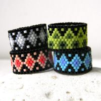 Colorful peyote rings by anabel27