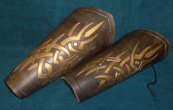Brow and gold tribal bracer by Feral-Workshop