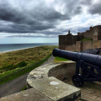 Bamburgh Castle Cannon by day-seriani
