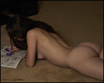 Emily coloring in her book by Gary-Melton