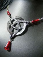 black leather triquetra with red beads by BacktoEarthCreations