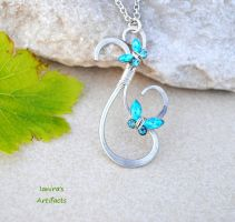 Turquoise crystal butterflies on a pendant! by IanirasArtifacts